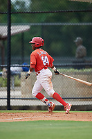 GCL Phillies East third baseman Edgar Made (24) follows through on a swing during a game against the GCL Blue Jays on August 10, 2018 at Carpenter Complex in Clearwater, Florida.  GCL Blue Jays defeated GCL Phillies East 8-3.  (Mike Janes/Four Seam Images)