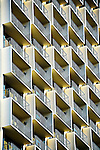 Repeating patterns of hotel balconies overlooking the San Antonio River.