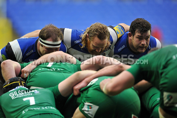 The Bath Rugby front row of Henry Thomas, Ross Batty and Nathan Catt prepare to scrummage. Aviva Premiership match, between London Irish and Bath Rugby on November 22, 2014 at the Madejski Stadium in Reading, England. Photo by: Patrick Khachfe / Onside Images