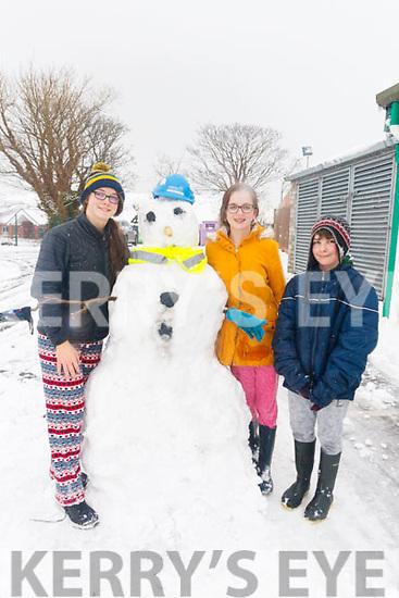 Annie ONeill, Doireann O'Neill and Johnny Finn, Castlegregory making snowman in Castlegregory on Friday