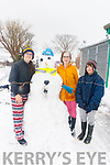 Annie ONeill, Doireann O'Neill and Johnny Finn, Castlegregory making snowman in Castlegregory on Friday