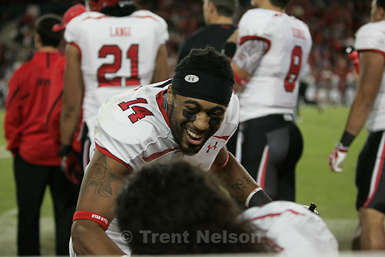 Trent Nelson  |  The Salt Lake Tribune.Utah's Reggie Dunn celebrates a second half touchdown as Utah faces Arizona, college football at Arizona Stadium in Tucson, Arizona, Saturday, November 5, 2011.