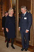London, Uk. 15/10/2015. HRH The Duchess of Cornwall with Michael Lake CBE, Director of the Royal Commonwealth Society. The Duchess of Cornwall on behalf of Her Majesty The Queen, Patron of The Royal Commonwealth Society, holds a reception for winners of The Queen's Commonwealth Essay Competition at Buckingham Palace. The Queen's Commonwealth Essay Competition was founded in 1883 and is the world's oldest international schools' writing contest. This year's competition, sponsored by Cambridge University Press, received more than 13,000 entries from over 600 schools in 49 Commonwealth countries and territories. The Duchess of Cornwall hands out awards to young writers who have travelled from across the Commonwealth to attend the reception. This year's winners have come from Cyprus, Botswana, The Cayman Islands and as far away as Tristan da Cunha - over 9000km away.