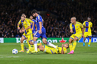 Diego Costa of Chelsea is fouled in the penalty box as Maccabi Tel-Aviv conceed their second penalty of the game during the UEFA Champions League match between Chelsea and Maccabi Tel Aviv at Stamford Bridge, London, England on 16 September 2015. Photo by David Horn.