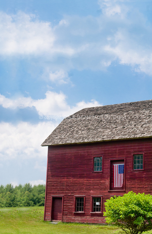 Beautiful red barn with American flag USA, blue skies