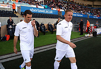 (L-R) Garry Monk and Sam Ricketts of Swansea Legends exit the tunnel during the Alan Tate Testimonial Match, Swansea City Legends v Manchester United Legends at the Liberty Stadium, Swansea, Wales, UK