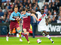West Ham's Declan Rice and Crystal Palace Cheikhou Kouyate during the Premier League match between West Ham United and Crystal Palace at the Olympic Park, London, England on 5 October 2019. Photo by Andrew Aleksiejczuk / PRiME Media Images.
