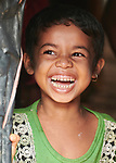A girl laughs in her home in the Jamtoli Refugee Camp near Cox's Bazar, Bangladesh. More than 600,000 Rohingya refugees have fled government-sanctioned violence in Myanmar for safety in this and other camps in Bangladesh.<br /> <br /> Parental consent obtained.