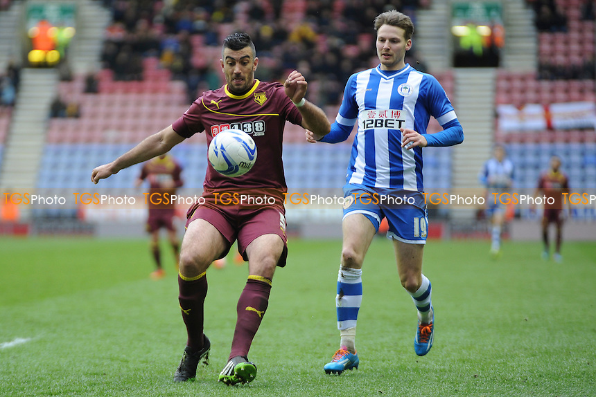 Essaid Belkalem of Watford controls the ball from Nick Powell of Wigan Athletic - Wigan Athletic vs Watford - Sky Bet Champiosnhip Football at the DW Stadium, Wigan - 22/03/14 - MANDATORY CREDIT: Greig Bertram/TGSPHOTO - Self billing applies where appropriate - 0845 094 6026 - contact@tgsphoto.co.uk - NO UNPAID USE