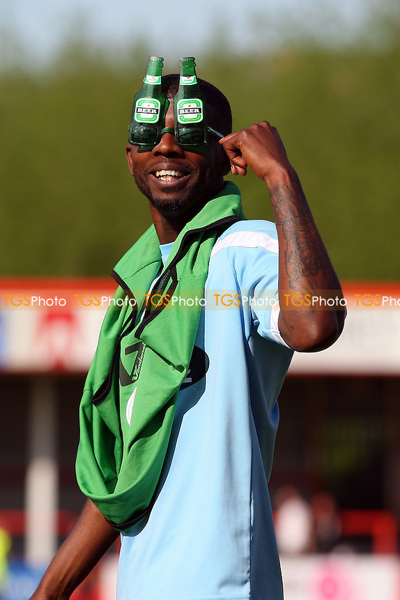 Medy Elito of Dagenham and Redbridge poses in a pair of funky sun glasses - Cheltenham Town vs Dagenham and Redbridge, Sky Bet League Two Football at the Whaddon Road Stadium - 03/05/14 - MANDATORY CREDIT: Dave Simpson/TGSPHOTO - Self billing applies where appropriate - 0845 094 6026 - contact@tgsphoto.co.uk - NO UNPAID USE