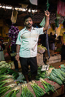 Kandy vegetable market, vegetable seller at his market stall, Kandy, Central Province, Sri Lanka Highlands, Asia. This is a photo of vegetable seller at his market stall in Kandy market, Kandy, Central Province, Sri Lanka Highlands, Asia.