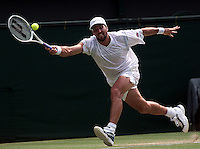 WIMBLEDON CHAMPIONSHIPS 2001 06/07/01 MENS SEMI-FINALS PAT RAFTER (AUSTRALIA) VOLLEYS  ON WAY TO THRILLING FIVE SET VICTORY OVER ANDRE AGASSI (USA) PHOTO ROGER PARKER