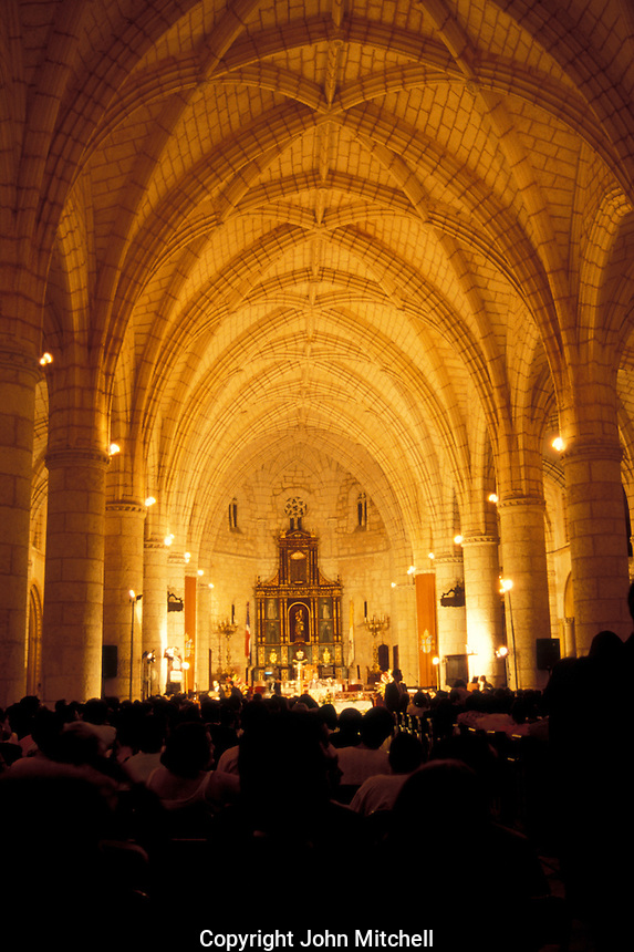 Interior of the Catedral Santa Maria la Menor in Santo Domingo, Dominican Republic, during Easter mass. This is the first cathedral built in the Americas. Santo Domingo's Zona Colonial was declared a UNESCO World heritage Site in 1990.