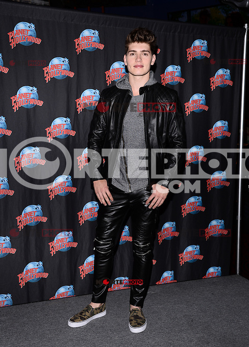 NEW YORK, NY - APRIL 22, 2014: Actor Gregg Sulkin of MTV's 'Faking It 'visits Planet Hollywood on Times Square, on April 22, 2014 in New York City RTNPluvious/Starlitepics