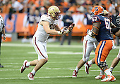 Boston College Eagles defensive end Brian Mihalik (99) rushes against Michael Lasker (67) during a game against the Syracuse Orange at the Carrier Dome on November 30, 2013 in Syracuse, New York.  Syracuse defeated Boston College 34-31.  (Copyright Mike Janes Photography)