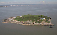 Pictured: Aerial view of Flat Holm island<br /> Re: Three sailors left cargo ship Alana Evita, moored two miles off Minehead on Tuesday night. The sailors left the ship in the evening on a rigid inflatable boat and headed for Barry in south Wales. They were reported overdue at 7am on Wednesday morning. The three had attempted to make their way back from Barry to Minehead on the rigid inflatable boat but got lost in foggy conditions in the channel.<br /> Minehead RNLI's Atlantic class lifeboat and Barry Dock's Trent all-weather lifeboat were launched just after 7am on Wednesday morning to assist in the search. As the search continued two lifeboats from Penarth RNLI, the Atlantic 85 and D-class lifeboat, along with Ilfracombe RNLI's Shannon class lifeboat also launched to assist at around 8am. All five lifeboats lifeboats carried out detailed searches along their coastlines.<br /> The sailors were found safe but very cold on Flat Holm Island at around 8:30am the same day by Penarth RNLI volunteers. After being assessed by the RNLI volunteers the Coastguard 187 helicopter landed on the island to further assess the casualties but it was decided they were well enough to return to land by lifeboat.<br /> All lifeboats have now been stood down and are returning to their relative stations.