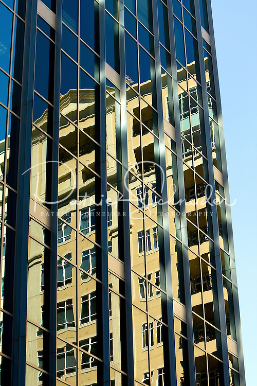 A condo building is reflected in the windows of an office building uptown Charlotte, NC.
