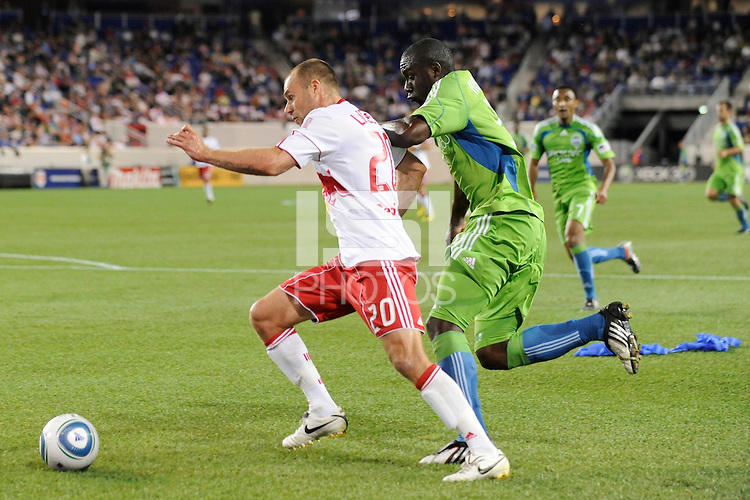 Joel Lindpere (20) of the New York Red Bulls tries to get around Jhon Kennedy Hurtado (34) of the Seattle Sounders. The Seattle Sounders defeated the New York Red Bulls 1-0 during a Major League Soccer (MLS) match at Red Bull Arena in Harrison, NJ, on May 15, 2010.