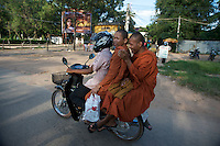 Siem Reap street scene, Monks on the back of a Motor Bike, Cambodia