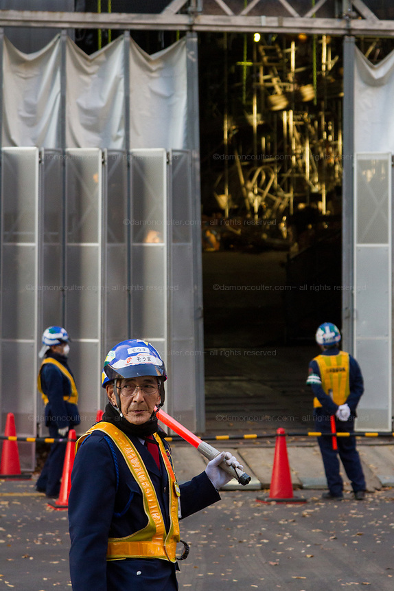 An old man employed as a safety and security guard at a construction site in Shinjuku,, Tokyo, Japan. Thursday December 12th 2019