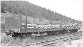 3/4 view of D&amp;RGW gondolas #9445 &amp; #9337 with sides removed and loaded with rock at Mears Junction.<br /> D&amp;RGW  Mears Junction, CO  Taken by Richardson, Robert W. - 1954