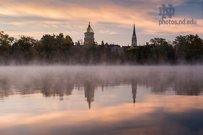 October 18, 2016; St. Joseph Lake at sunrise with the Main Building and Golden Dome in the background. (Photo by Barbara Johnston/University of Notre Dame)