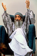 Wasco, Oregon, January 1984: Portrait of Bhagwan Rajneesh at different occasions.   Rajneeshpuram, was an intentional community in Wasco County, Oregon, briefly incorporated as a city in the 1980s, which was populated with followers of the spiritual teacher Osho, then known as Bhagwan Shree Rajneesh. The community was developed by turning a ranch from an empty rural property into a city complete with typical urban infrastructure, with population of about 7000 followers.