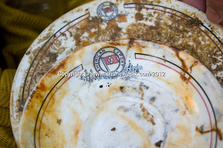 Crockery bearing the names of the shipping line 'American Export Lines' recovered from the shipwreck of the S.S. Exmouth. This clue was essential in piecing together the history to enable identifying the wreck when first dived in 2008.