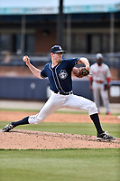 Asheville Tourists starting pitcher Brandon Gold (18) delivers a pitch during a game against the Greenville Drive at McCormick Field on April 16, 2017 in Asheville, North Carolina. The Drive defeated the Tourists 4-2. (Tony Farlow/Four Seam Images)