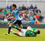 June 4th 2017, Aviva Stadium, Dublin, Ireland; International football friendly, Republic of Ireland versus Uruguay; Cyrus Christie (Republic of Ireland) slides in to challenge Jonathan Urretaviscaya (Uruguay)