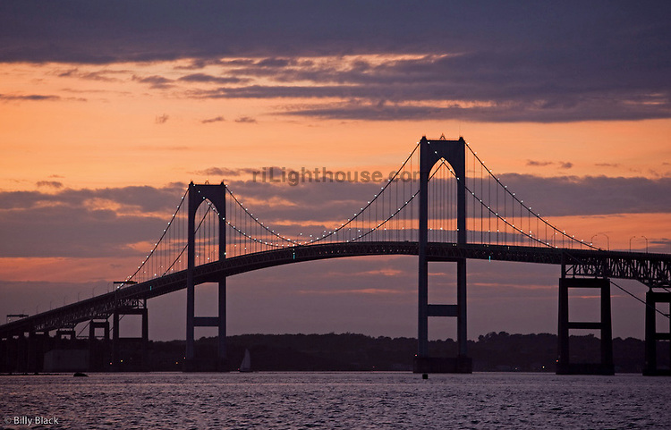Lights begin to shine on Newport Bridge as the sun set
