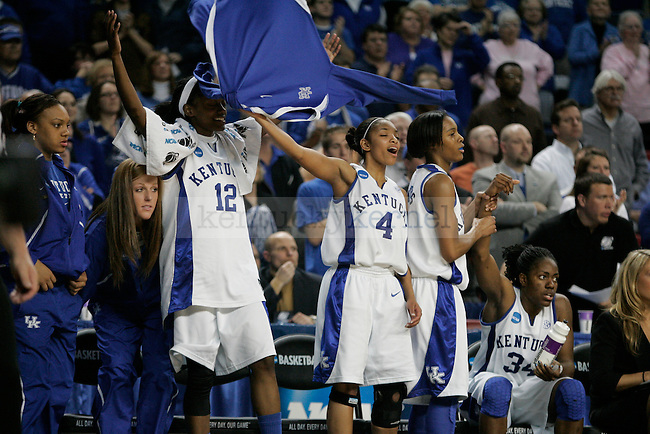 The Kentucky Women's basketball team celebrates on the bench with a large lead toward the end of the game against Michigan State at Freedom Hall on Monday, March 22, 2010. Photo by Scott Hannigan | Staff