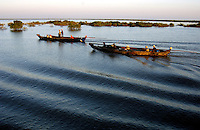 CRUISING THE TONLE SAP LAKE IN CAMBODIA, TRDITIONAL BOATS AT SUNSET