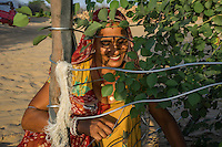 Manju Devi, 25, tends to a tree in her backyard plantation of forest trees behind her house in Rajera village, Bikaner, Rajasthan, India on October 23, 2016. Non-profit organisation Technoserve works with farmer's wives in Bikaner, providing technical support and training for backyard plantations that help these communities cope with the harsh climate of the Thar desert. The forest trees provide shade to the people and their cattle, reduces water loss and sand shifting, raises the value of their properties by improvement of the landscape and raises the pride of their families, ensuring better opportunities for their children. Photograph by Suzanne Lee for Technoserve