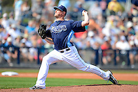 Tampa Bay Rays pitcher Jake McGee #57 delivers a pitch during a Grapefruit League Spring Training game against the Boston Red Sox at Charlotte County Sports Park on February 25, 2013 in Port Charlotte, Florida.  Tampa Bay defeated Boston 6-3.  (Mike Janes/Four Seam Images)