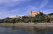 Bratislava, Slovakia. View of the city with the Castle and the goverment building; Danube in the foreground.