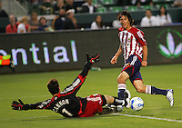LA Galaxy goalkeeper Joe Cannon (1)  defends his goal against CD Chivas USA midfielder Sacha Klejestan (16). CD Chivas USA defeated the LA Galaxy 3-0 in the Super Classico MLS match at the Home Depot Center in Carson, California, Thursday, August 23, 2007.