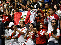BOGOTÁ-COLOMBIA, 07-01-2020: Hinchas de Perú, animan a su equipo antes de partido entre Argentina y Perú, en el Preolímpico Suramericano de Voleibol, clasificatorio a los Juegos Olímpicos Tokio 2020, jugado en el Coliseo del Salitre en la ciudad de Bogotá del 7 al 9 de enero de 2020. / Fans from Peru cheer for their team prior a match between Argentina and Peru, in the South American Volleyball Pre-Olympic Championship, qualifier for the Tokyo 2020 Olympic Games, played in the Colosseum El Salitre in Bogota city, from January 7 to 9, 2020. Photo: VizzorImage / Luis Ramírez / Staff.