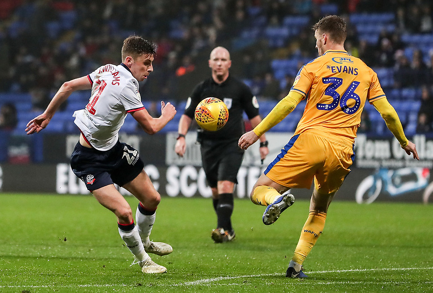 Bolton Wanderers' Joe Williams competing with Wigan Athletic's Lee Evans<br /> <br /> Photographer Andrew Kearns/CameraSport<br /> <br /> The EFL Sky Bet Championship - Bolton Wanderers v Wigan Athletic - Saturday 1st December 2018 - University of Bolton Stadium - Bolton<br /> <br /> World Copyright © 2018 CameraSport. All rights reserved. 43 Linden Ave. Countesthorpe. Leicester. England. LE8 5PG - Tel: +44 (0) 116 277 4147 - admin@camerasport.com - www.camerasport.com