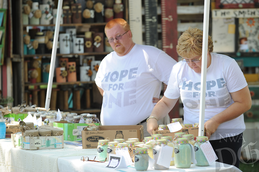 NWA Democrat-Gazette/ANDY SHUPE<br /> Visitors attend Friday, Aug. 7, 2015, during the 117th annual Tontitown Grape Festival. The Run for the Grapes begins at 7 a.m. today followed by the arts and crafts fair at 10 a.m. The midway is open from noon until 11 p.m.