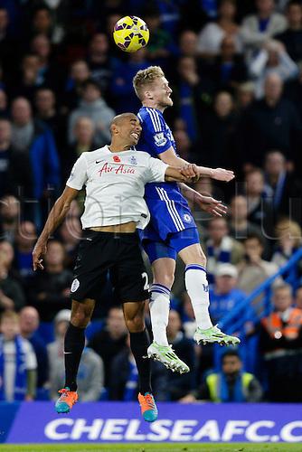 01.11.2014.  London, England. Premier League. Chelsea versus Queens Park Rangers.  Chelsea's Andre Schurrle & QPR's Karl Henry battle in an aerial challenge