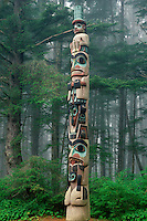 Totem poles in Sitka spruce forest<br /> Sitka National Historical Park<br /> Sitka,  Baranof Island<br /> Southest Alaska