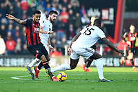 Willy Boly of Wolverhampton Wanderers puts a foot on Joshua King of AFC Bournemouth during AFC Bournemouth vs Wolverhampton Wanderers, Premier League Football at the Vitality Stadium on 23rd February 2019