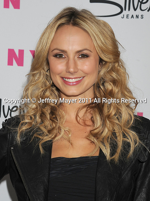 HOLLYWOOD, CA - MARCH 24: Stacy Keibler  arrives at NYLON Magazine's 12th Anniversary Issue Party With The Cast of Sucker Punch at Tru Hollywood on March 24, 2011 in Hollywood, California.