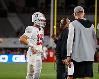 LOS ANGELES, CA - SEPTEMBER 8: Stanford Cardinal head coach David Shaw talks with quarterback Davis Mills #15 during a timeout during a game between USC and Stanford Football at Los Angeles Memorial Coliseum on September 7, 2019 in Los Angeles, California.