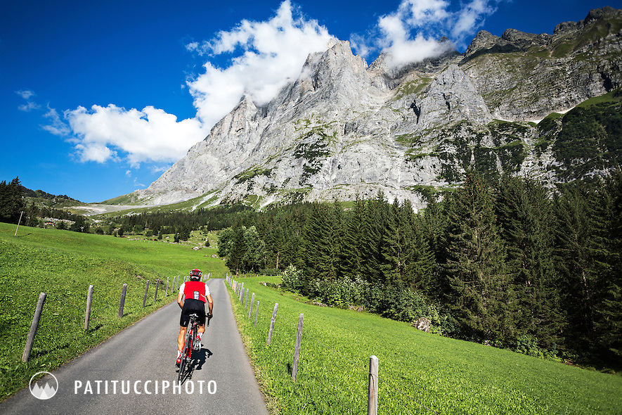 One man cycling up the Grosse Scheidegg Pass from Grindelwald, Switzerland. Above is the Wetterhorn.