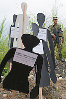 A soldier guards the commemoration of the National Movement of Victims of State Crimes, MOVICE, commemorate this April 9 as the Day of Memory and Solidarity with Victims of state crimes, this time of vital importance for the country as it was from when triggered, significantly, the political conflict, social and armed, that today, after decades, continues in the form of persecution, threats and harassment against land claimants leaders and advocates humans. In the district there are 13 mass graves containing more than 1000 dead buried in a dump that works in the area. The close calls that dump MOVISE and declare the area as a cemetery. In Colombia, this time away from a transitional or post. More than 60 leaders killed lands (at least 26 of these victims killed between 2010 and 2011), the reengineering of paramilitarism in over 400 municipalities, more than 1,400 displaced people killed since 2007, a development model based on dispossession and displacement.. In Medellín, Colombia. 09/04/2012. Photo by Fredy Amariles/VIEWpress.