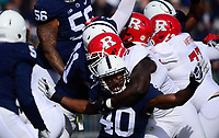 STATE COLLEGE, PA - NOVEMBER 11:  Penn State LB Jason Cabinda (40) is held around the neck by Rutgers T Kamal Seymour (54) as Cabinda tries to block a field goal kick. The Penn State Nittany Lions defeated the Rutgers Scarlet Knights 35-6 on November 11, 2017 at Beaver Stadium in State College, PA. (Photo by Randy Litzinger/Icon Sportswire)