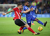31st October 2017, Cardiff City Stadium, Cardiff, Wales; EFL Championship football, Cardiff City versus Ipswich Town; Luke Chambers (C) of Ipswich Town clears the ball down the line as he is pressured by Junior Hoilett of Cardiff City