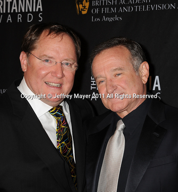 BEVERLY HILLS, CA - NOVEMBER 30: John Lasseter and Robin Williams arrive at BAFTA Los Angeles 2011 Britannia Awards at The Beverly Hilton Hotel on November 30, 2011 in Beverly Hills, California.